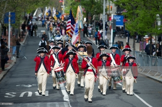 Philadelphia, PA, USA - Apr. 19, 2017; Parade leads officials, members of Color Guards and re-enactors from Independence Hall, towards the official opening and ribbon cutting ceremony of the Museum of the American revolution, in Philadelphia, PA. The new multimillion dollar attraction, featuring 32,000 square feet of exhibits, opened its doors to the general public in April 2017, and is located in Philadelphia's historic district, blocks from Independence Hall.
